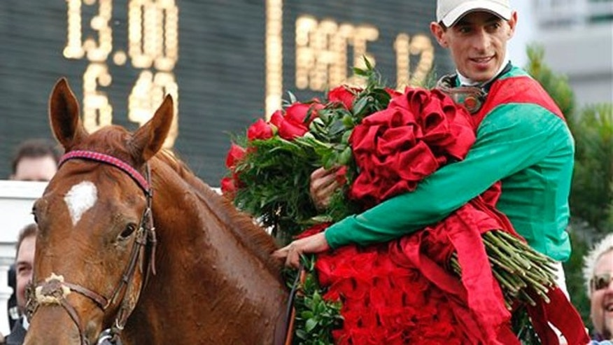 John Velazquez holds the Blanket of Roses after riding Animal Kingdom to victory during the 137th Kentucky Derby horse race at Churchill Downs Saturday, May 7, 2011, in Louisville, Ky. (AP Photo/Michael Conroy)