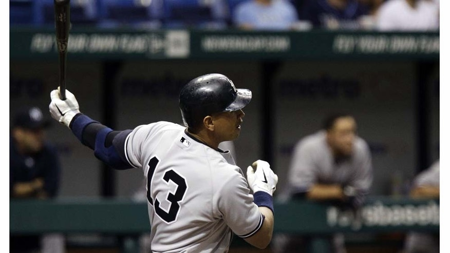 New York Yankees' Alex Rodriguez follows his sixth-inning home run off Tampa Bay Rays starting pitcher James Shields during a baseball game Tuesday, May 17, 2011 in St. Petersburg, Fla. (AP Photo/Chris O'Meara)