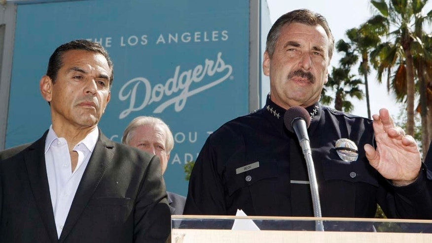 Los Angeles Police Chief Charlie Beck, right, with Mayor Antonio Villariagosa. announces the arrest of a suspect in connection with the March 31 beating of San Francisco Giants fan Bryan Stow at Dodger Stadium, during a news conference, Sunday, May 22, 2011, at the stadium in Los Angeles. The suspect, whose name was not immediately released, was among several people detained for questioning after police served search warrants. (AP Photo/Reed Saxon)