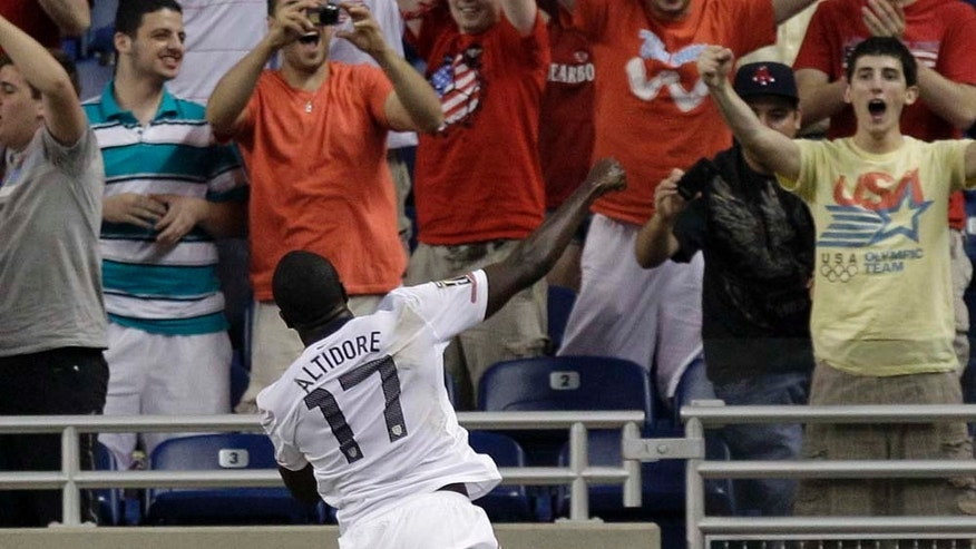 Jozy Altidore celebrates after scoring against Canada in Gold Cup match.