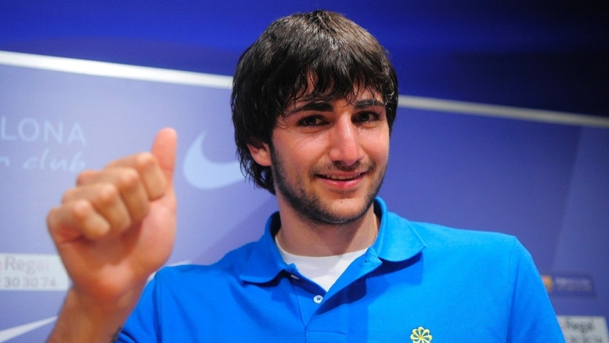 June 17: Spanish basketball player Ricky Rubio gestures during a press conference at the Nou Camp stadium in Barcelona, Spain. Ricky Rubio is joining the Minnesota Timberwolves. (AP Photo/Manu Fernandez)