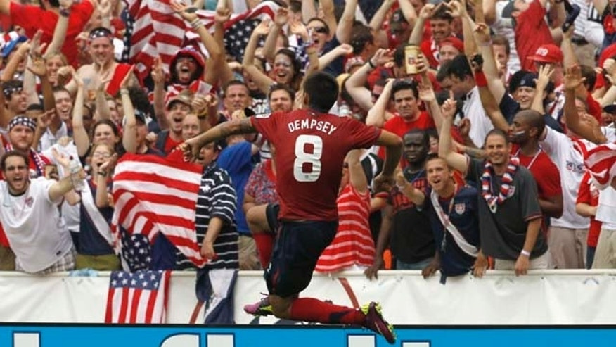 United States' Clint Dempsey (8) reacts after his goal during the second half of a CONCACAF Gold Cup quarterfinal soccer match against Jamaica on Sunday, June 19, 2011, at RFK Stadium in Washington. The United States won 2-0. (AP Photo/Alex Brandon)