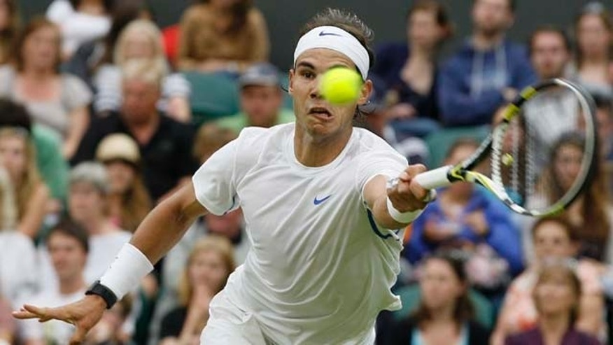Spain's Rafael Nadal returns a shot to Ryan Sweeting of the US at the All England Lawn Tennis Championships at Wimbledon, Wednesday, June 22, 2011. (AP Photo/Kirsty Wigglesworth)