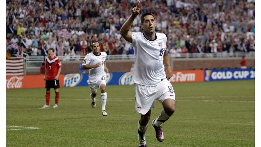 United States forward Clint Dempsey (8) celebrates his goal against Canada in the second half of a CONCACAF Gold Cup soccer match at Ford Field in Detroit, Tuesday, June 7, 2011. (AP Photo/Paul Sancya)
