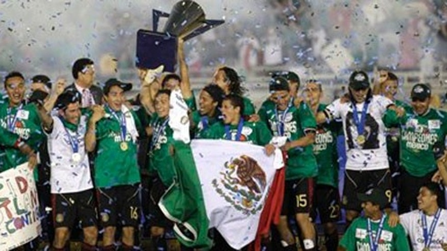 Mexico celebrates their victory over the United States in the Gold Cup final in Pasadena, California. U.S. goalkeeper Tim Howard took exception to an all-Spanish post-game ceremony on U.S. soil.