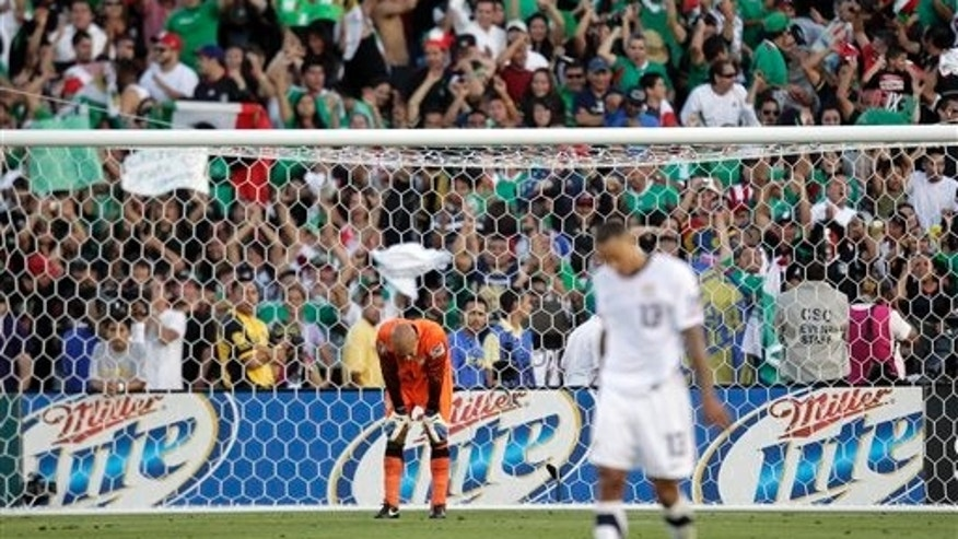 U.S. goalkeeper Tim Howard  reacts as soccer fans celebrate a goal by Mexico's Giovani Dos Santos during the second half of CONCACAF Gold Cup final soccer match.