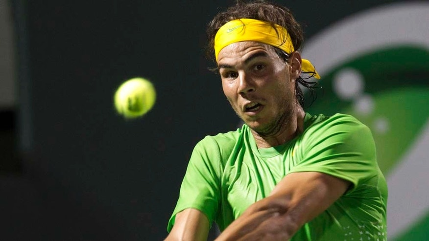 Rafael Nadal, from Spain, returns the ball to Alexandr Dolgopolov, of Ukraine, at the Sony Ericsson Open tennis tournament in Key Biscayne, Fla., Tuesday, March 29, 2011. Nadal won 6-1, 6-2.(AP Photo/J Pat Carter)