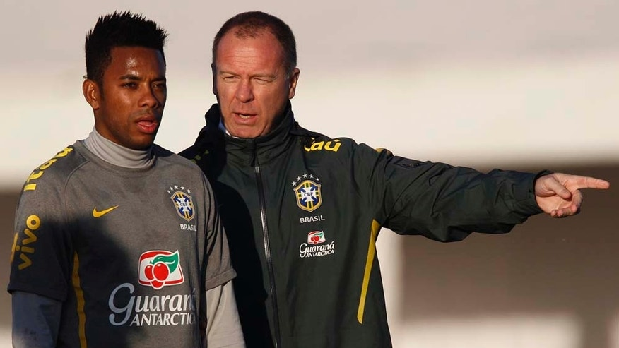 Brazil's soccer coach Mano Menezes, right, talks to player Robinho during a training session ahead of the upcoming 2011 Copa America in Campana, Argentina, Monday, June 27, 2011. Argentina will host the Copa America soccer tournament from July 1 to July 24. (AP Photo/Natacha Pisarenko)