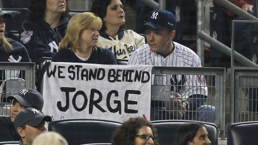 NEW YORK, NY - MAY 15: A fan holds a sign in support of Jorge Posada of the New York Yankees during their game against the Boston Red Sox on May 15, 2011 at Yankee Stadium in the Bronx borough of New York City. (Photo by Al Bello/Getty Images)