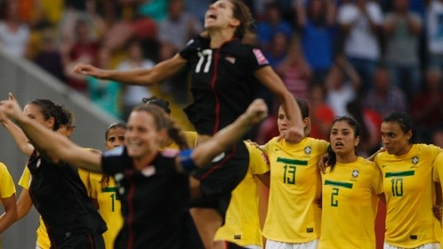 US players celebrate after winning in a penalty shootout the quarterfinal match between Brazil and the United States at the Womens Soccer World Cup in Dresden, Germany, Sunday, July 10, 2011. (AP Photo/Petr David Josek)