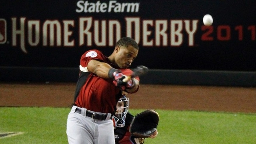 American League's Robinson Cano of the New York Yankees hits the winning home run at the MLB Home Run Derby Monday, July 11, 2011, in Phoenix. (AP Photo/Ross D. Franklin)