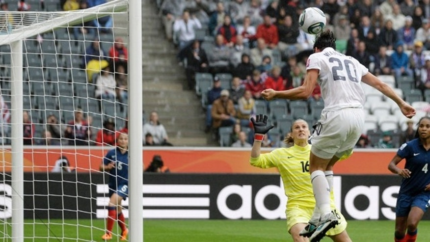 United States' Abby Wambach, right, heads the ball past France goalkeeper Berangere Sapowicz during the semifinal match between France and the United States at the Womens Soccer World Cup in Moenchengladbach, Germany, Wednesday, July 13, 2011. (AP Photo/Marcio Jose Sanchez)