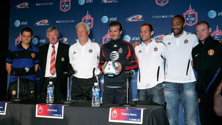 "July 25: Javier ""Chicarito"" Hernandez of Manchester United, Manchester United Head Coach Sir Alex Ferguson, MLS All-Stars Head Coach Hans Backe, MLS All-Star David Beckham, MLS All-Star Brad Davis, MLS All-Star Thierry Henry and Wayne Rooney of Manchester United."