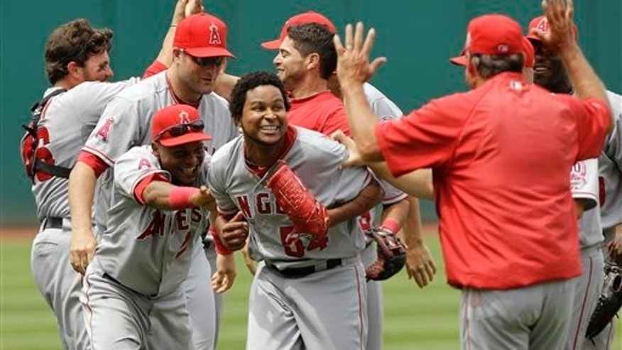 Los Angeles Angels starting pitcher Ervin Santana, center, celebrates with his teammates after pitching a no-hitter against the Cleveland Indians in a 3-1 win of a baseball game Wednesday, July 27, 2011, in Cleveland. (AP Photo/Mark Duncan)