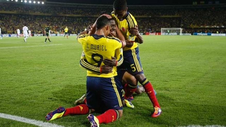 Colombia's Jose Valencia, center, celebrates with teammates after scoring during a U-20 World Cup group A soccer match against Mali in Bogota, Colombia, Tuesday, Aug. 2, 2011. (AP Photo/Dolores Ochoa)