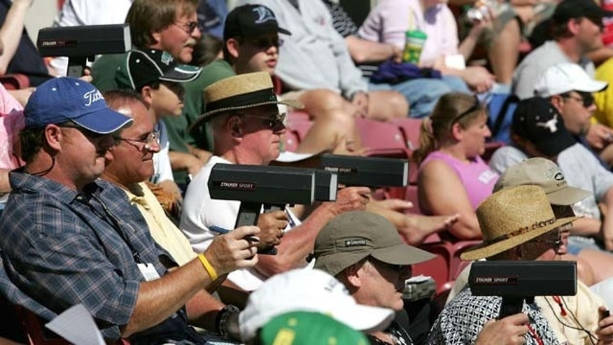 ST. PETERSBURG, FL - MARCH 6:  MLB team scouts keep their radar guns trained on the pitchers during MLB Spring Training action on March 6, 2005 at the Progress Energy Park in St. Petersburg, Florida. The Tampa Bay Devil Rays defeated the Pittsburgh Pirates 5-3.  (Photo by Doug Pensinger/Getty Images)