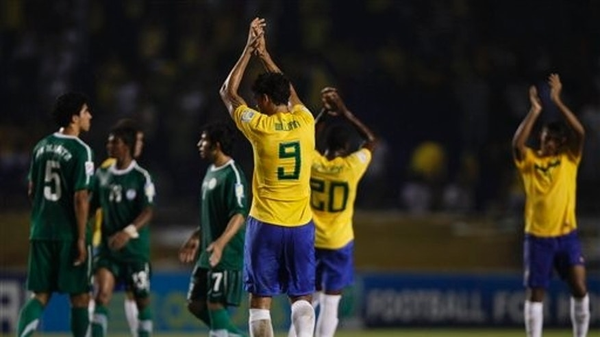 Aug 10: Brazil players celebrates at the end of a U-20 World Cup round of 16 soccer match against Saudi Arabia in Barranquilla, Colombia. Brazil won 3-0. (AP Photo/Fernando Llano)