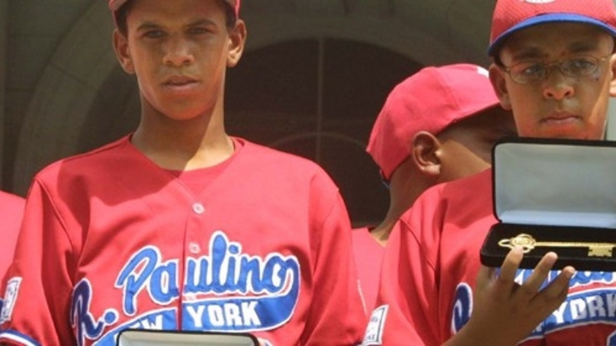 393788 05: (FILE PHOTO) Danny Almonte (C) and other members of the Rolando Paulino All-Stars Bronx Little League baseball team hold their keys to the city during a ceremony honoring the team August 28, 2001 in New York City. Dominican Republic officials said August 31, 2001 that Little League pitcher Danny Almonte is 14 years old, not 12 years old. The finding could strip his team of its third-place finish in the World Series. (Photo by Mario Tama/Getty Images)