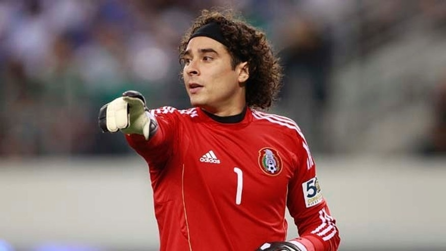 ARLINGTON, TX - JUNE 05:  Guillermo Ochoa #1 of Mexico gestures to the referee during the match against El Salvador at the CONCACAF Gold Cup qualifying match at Cowboys Stadium on June 5, 2011 in Arlington, Texas.  (Photo by Rick Yeatts/Getty Images)