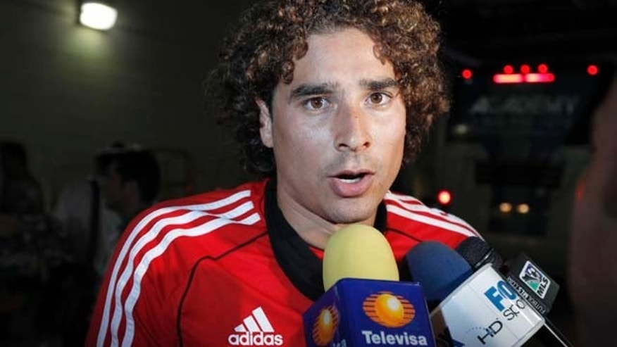 Mexico's goalkeeper Guillermo Ochoa speaks during a media availability at Lincoln Financial Field, Tuesday, Aug. 9, 2011 in Philadelphia. The Mexican Football Federation plans to stand by its decision to clear Ochoa and four players of doping. (AP Photo/Alex Brandon)