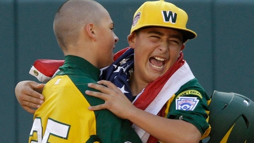 Aug 28: Huntington Beach, Calif.'s Nick Pratto, left, celebrates with teammate Braydon Salzman after driving in the winning run with a walk-off single off Hamamatsu City, Japan, pitcher Kazuto Takakura to win the Little League World Series Championship baseball game in South Williamsport, Pa. California won 2-1. (AP Photo/Gene J. Puskar)