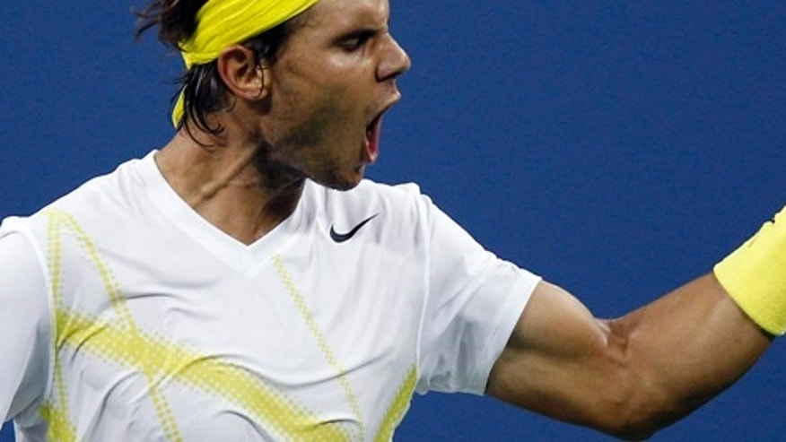 Rafael Nadal, of Spain, pumps his fist after beating Andrey Golubev, of Kazakhstan, 6-3, 7-6 (1),7-5 during the first round of the U.S. Open tennis tournament in New York, Tuesday, Aug. 30, 2011. (AP Photo/Charles Krupa)