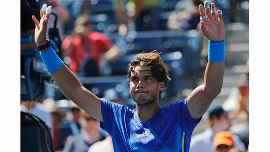 Rafael Nadal of Spain reacts after winning his match against Gilles Muller of Luxembourg during the U.S. Open tennis tournament in New York, Thursday, Sept. 8, 2011. (AP Photo/Mike Groll)