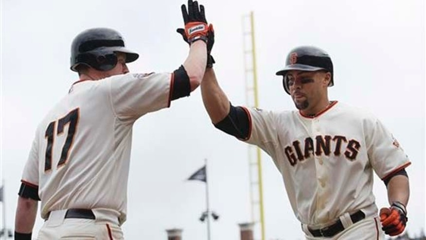 Sept. 14, 2011: San Francisco Giant's Carlos Beltran, right, celebrates with Aubrey Huff after hitting a solo home run off of San Diego Padres starting pitcher Mat Latos in the sixth inning of a baseball game in San Francisco, on Wednesday.. It was Beltran's 300th career home run and his second home run of the day.