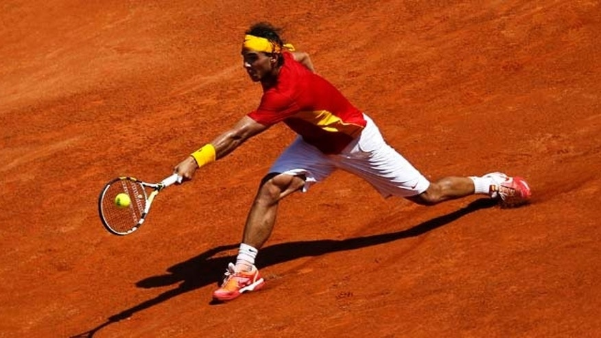 Spain's Rafael Nadal plays a shot during a Davis Cup semi-final tennis match against France's Richard Gasquet in the bullring in Cordoba, Spain, Friday, Sep. 16, 2011. (AP Photo/Sergio Torres)