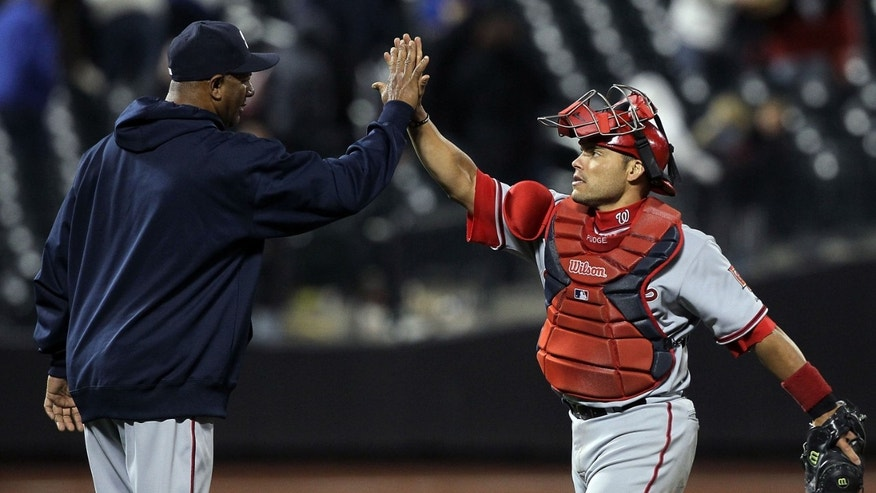 2010: Ivan Rodriguez #7 and Livan Hernandez #61 of the Washington Nationals (Photo by Jim McIsaac/Getty Images)