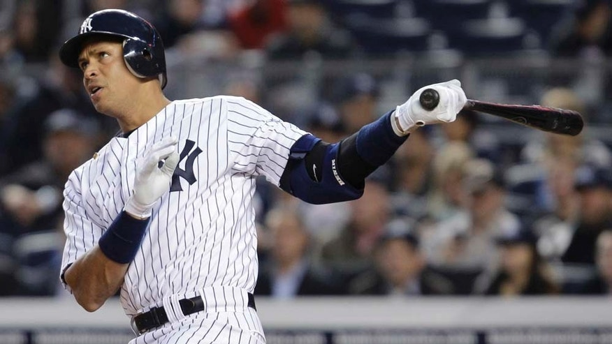 New York Yankees' Alex Rodriguez watches a home run sail off of his bat.