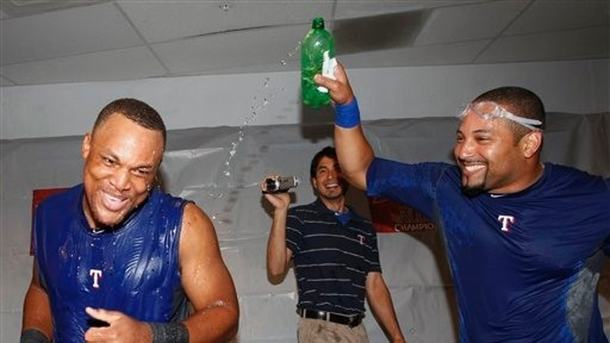 Oct 4: Texas Rangers Adrian Beltre, left, and Yorvit Torrealba celebrate their win over the Tampa Bay Rays to clinch the American League division series. Beltre hit three home runs in Game 4 to help defeat the Rays 4-3.