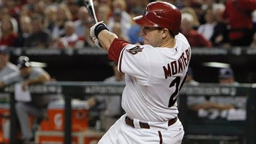 Oct 4: Arizona Diamondbacks Miguel Montero singles to score Aaron Hill in the third inning of Game 3 of baseball's National League division series against the Milwaukee Brewers on Tuesday.