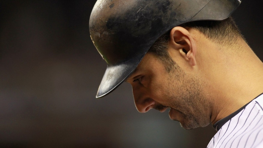 Oct 6:  Jorge Posada of the New York Yankees walks back to the dugout with his head down after he grounded out in the bottom of the eighth inning against the Detroit Tigers during Game Five of the American League Championship Series at Yankee Stadium.