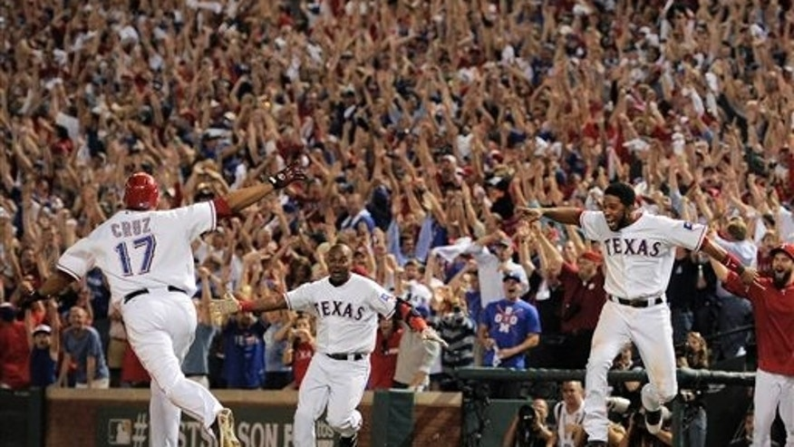 Oct 10: Texas Rangers Nelson Cruz, left, and teammates react after he hit a grand slam home run in the 11th inning of Game 2 of the American League championship series to beat the Detroit Tigers 7-3.