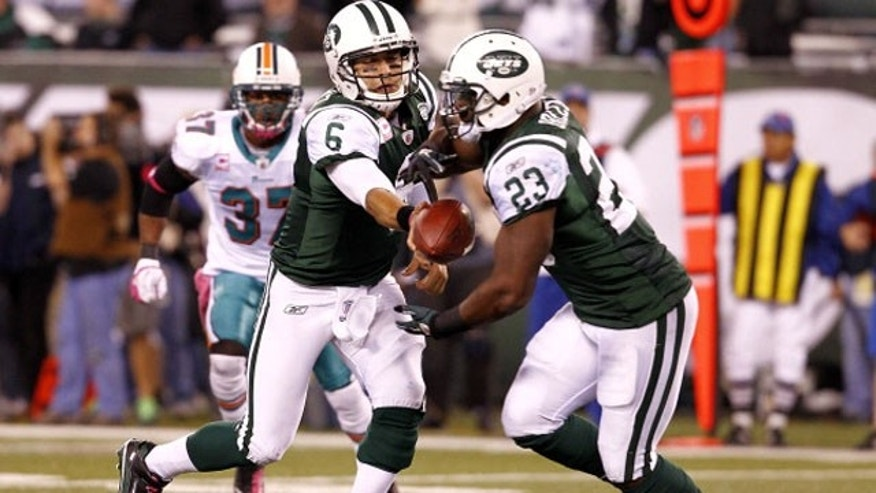 EAST RUTHERFORD, NJ - OCTOBER 17:   Mark Sanchez #6 hands off to Shonn Greene #23 of the New York Jets during their game against the Miami Dolphins at MetLife Stadium on October 17, 2011 in East Rutherford, New Jersey.  (Photo by Jeff Zelevansky/Getty Images)