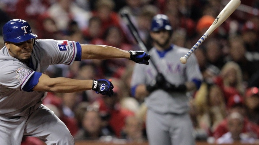 Texas Rangers' Nelson Cruz loses his bat during the fifth inning of Game 2 of baseball's World Series against the St. Louis Cardinals Thursday, Oct. 20, 2011, in St. Louis. (AP Photo/Charlie Riedel)