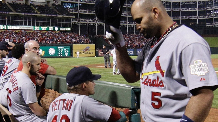 St. Louis Cardinals' Albert Pujols reacts as he walks back to the dugout after flying out during the ninth inning of Game 4 of baseball's World Series against the Texas Rangers Sunday, Oct. 23, 2011, in Arlington, Texas. The Rangers won 4-0 to tie the series at 2-2. (AP Photo/Matt Slocum)