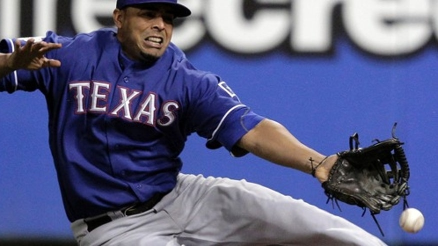 Oct 19: Texas Rangers right fielder Nelson Cruz can't come up with a hit by St. Louis Cardinals' Allen Craig during the sixth inning of Game 1 of baseball's World Series in St. Louis. (AP Photo/Charlie Riedel)