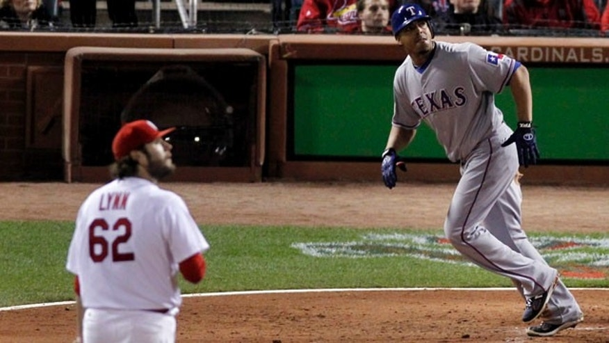 Texas Rangers' Nelson Cruz watches his solo home run off a pitch by St. Louis Cardinals' Lance Lynn during the seventh inning of Game 6 of baseball's World Series Thursday, Oct. 27, 2011, in St. Louis. (AP Photo/Jeff Roberson)