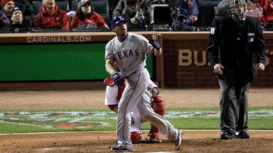 ST LOUIS, MO - OCTOBER 27: Nelson Cruz #17 of the Texas Rangers watches the ball after hitting a solo home run in the seventh inning during Game Six of the MLB World Series against the St. Louis Cardinals at Busch Stadium on October 27, 2011 in St Louis, Missouri.  (Photo by Rob Carr/Getty Images)