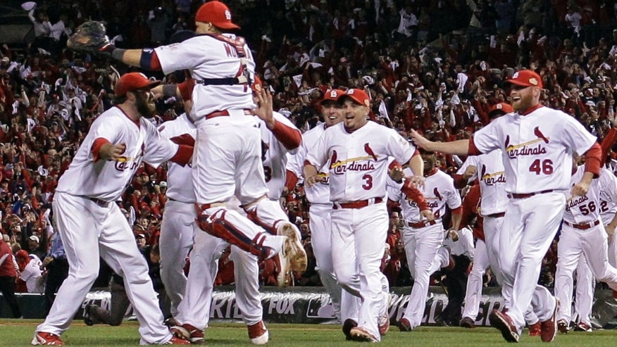 The St. Louis Cardinals celebrate after Texas Rangers' David Murphy flies out to end Game 7 of baseball's World Series Friday, Oct. 28, 2011, in St. Louis. The Cardinals won 6-2 to win the series.  (AP Photo/Matt Slocum)