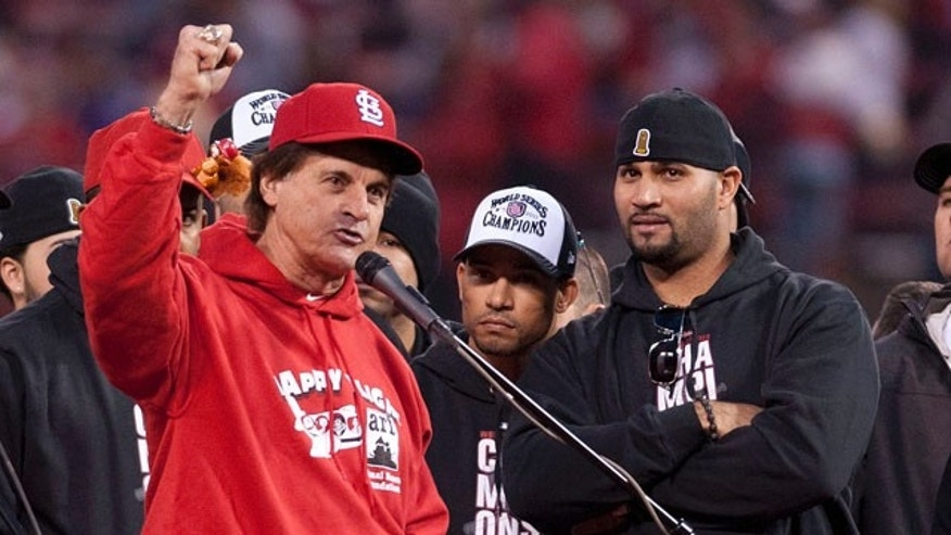 ST. LOUIS, MO - OCTOBER 30: Manager Tony LaRussa of the St. Louis Cardinals excites the Busch Stadium crowd during his victory parade speech on October 30, 2011 in St Louis, Missouri. (Photo by Ed Szczepanski/Getty Images)