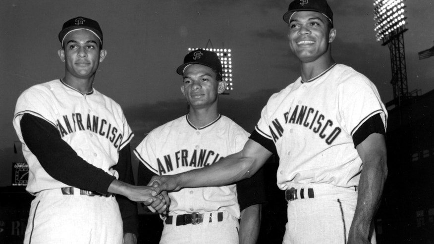FILE - In this Sept. 10, 1963 file photo, San Francisco outfielders, from left, Jesus Alou, Matty Alou, and Felipe Alou, of the Dominican Republic, pose in a three-way hand shake before start of a baseball game with the New York Mets at New York's Polo Grounds. Matty Alou died in his native Dominican Republic. He was 72. His former Dominican team, Leones del Escogido, said he died Thursday, N ov. 3, 2011 of complications related to diabetes.  (AP Photo/File)
