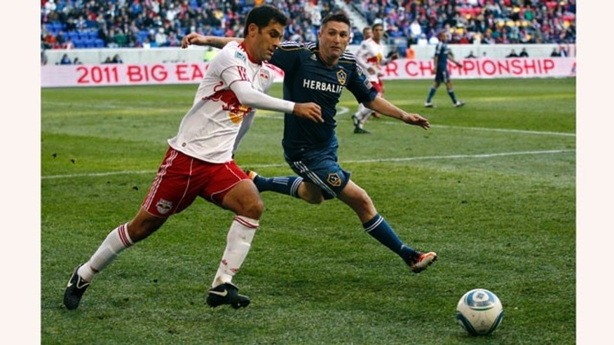 New York Red Bulls defender Rafa Marquez, left, of Mexico, tries to get the ball away from Los Angeles Galaxy forward Robbie Keane (14), of Ireland, during the second period of an MLS soccer match Sunday, Oct. 30, 2011, Newark, N.J. Galaxy won 1-0. (AP Photo/Mel Evans)