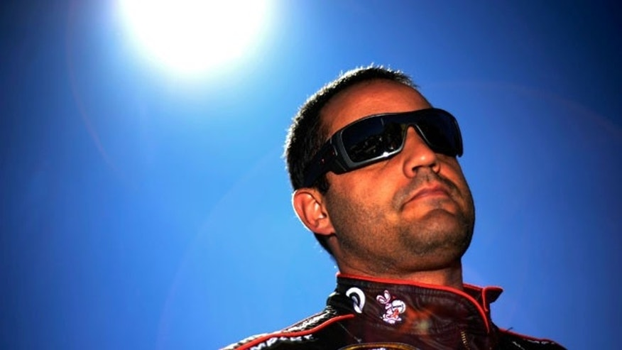 TALLADEGA, AL - OCTOBER 22: Juan Pablo Montoya, driver of the #42 Energizer Chevrolet, stands on the grid after qualifying for the NASCAR Sprint Cup Series Good Sam Club 500 at Talladega Superspeedway on October 22, 2011 in Talladega, Alabama.  (Photo by Jason Smith/Getty Images)