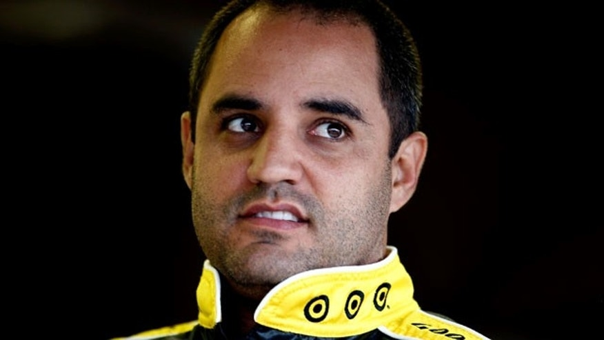 LOUDON, NH - SEPTEMBER 24:  Juan Pablo Montoya, driver of the #42 Degree Men Chevrolet, looks on in the garage practice for the NASCAR Sprint Cup Series Sylvania 300 at New Hampshire Motor Speedway on September 24, 2011 in Loudon, New Hampshire.  (Photo by Jeff Zelevansky/Getty Images)