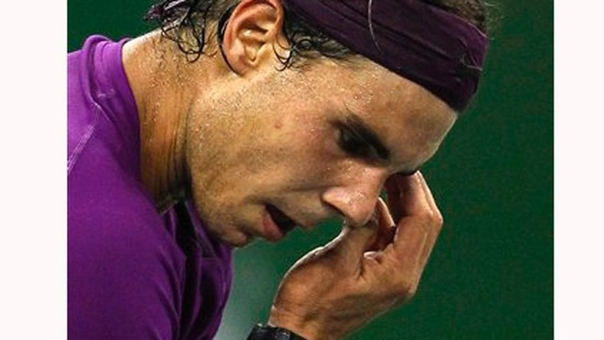Oct. 13, 2011: Beads of sweat drip as Rafael Nadal of Spain prepares to serve during his third round match against Florian Mayer of Germany at the Shanghai Masters tennis tournament in Shanghai, China on Thursday.