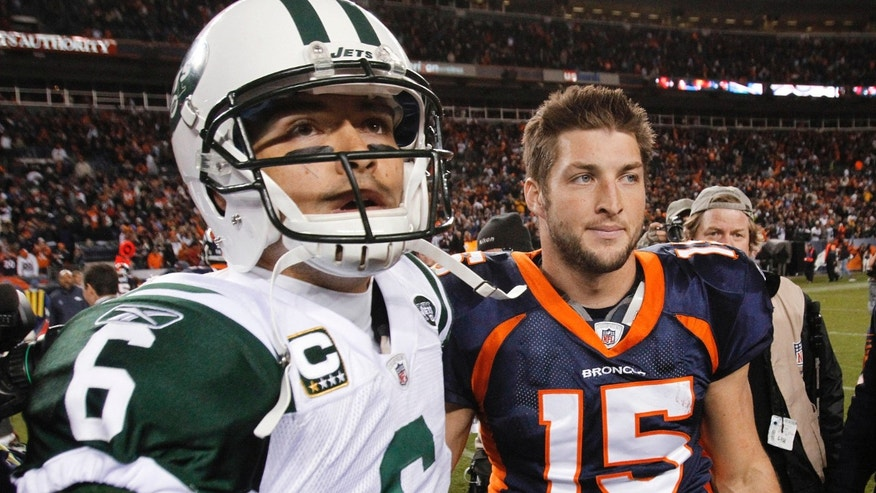 New York Jets quarterback Mark Sanchez (6) and Denver Broncos quarterback Tim Tebow (15) walk off the field together after an NFL football game Thursday, Nov. 17, 2011, in Denver. The Broncos won 17-13. (AP Photo/Barry Gutierrez)