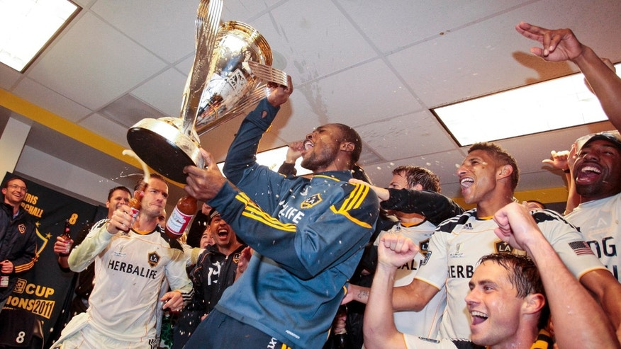 Los Angeles Galaxy goalkeeper Donovan Ricketts, middle, celebrates with his teammates after the Galaxy defeated the Houston Dynamo 1-0 in the MLS Cup championship soccer match, Sunday, Nov. 20, 2011, in Carson, Calif. (AP Photo/Bret Hartman)